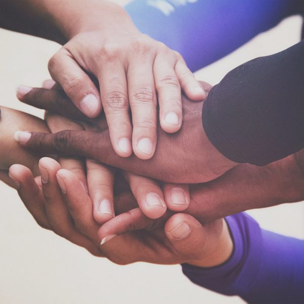 diverse-group-of-people-holding-hands-in-supportive-gesture_t20_QQbmOW-scaled.jpg
